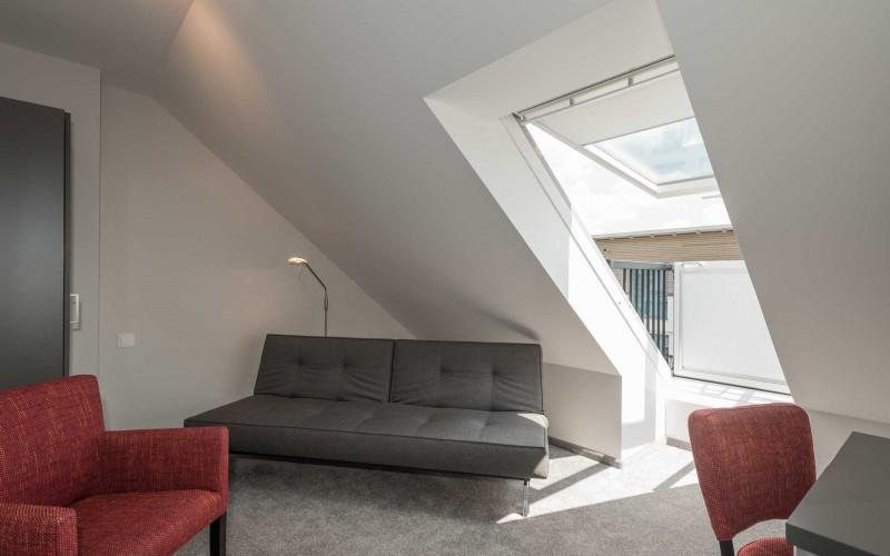 Residence Suite - Wohnraum mit Esstisch, Küchenzeile und Wohnzimmer